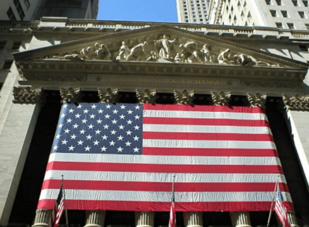 New York Stock Exchange building with large American flag