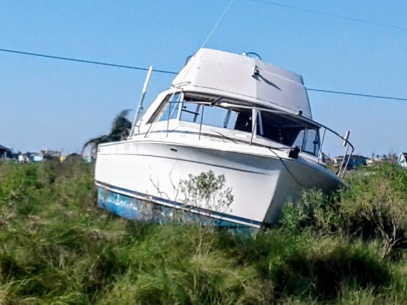 Rockport, TX: a rather large boat sits in a field nowhere near the water.