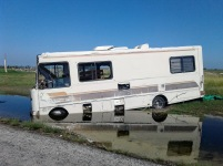 Rockport, TX: Somebody's RV ended up nose first in a puddle of flood water.