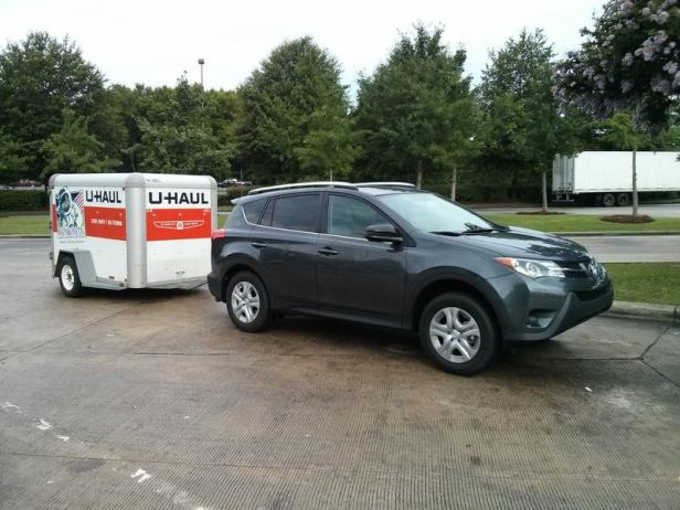 U-Haul trailer behind crossover style vehicle